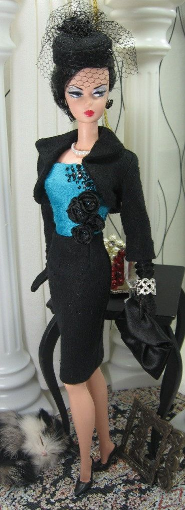 Barbie in Black and Turquoise suit.