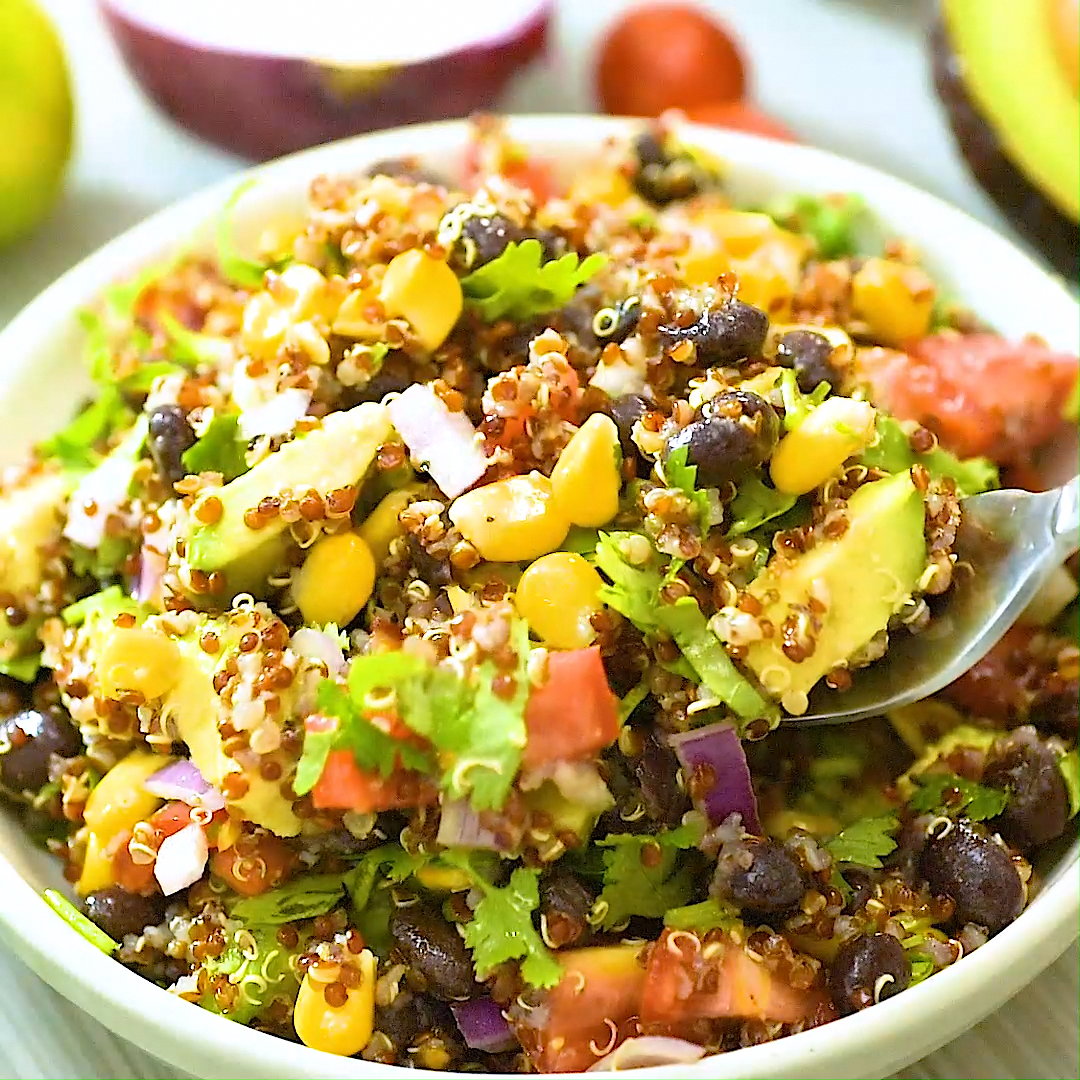 This Mexican-style Quinoa Salad is loaded with black beans, corn, tomatoes, avocados, red onion, an