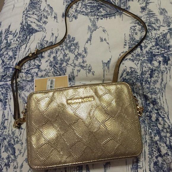 da51f32a84e0 Michael Kors Jet Set Travel Large Crossbody Bag Luxe metallic cobra-embossed  leather grace this
