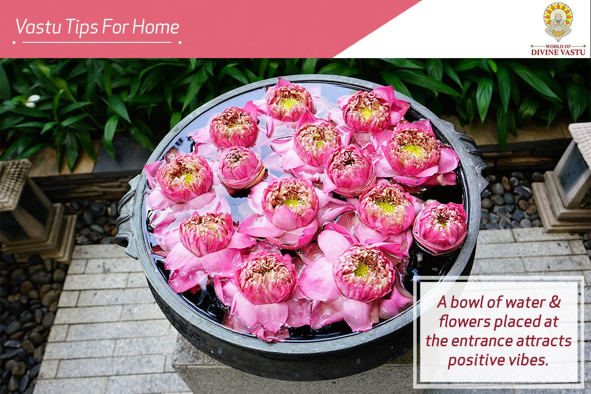 A Bowl Filled With Water Flowers Kept Facing The Main Door Is