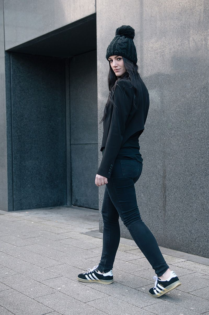 8f2c19fa29c Fashion blogger Stephanie of FAIIINT wearing OASAP pom pom beanie,  Theyskens' Theory Cropped Jacket, ASOS Tank Top, Topshop Skinny Jeans, Adidas  Gazelle ...