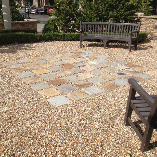 Pea gravel or small river rocks with slate tile pieces for How to build a river rock patio