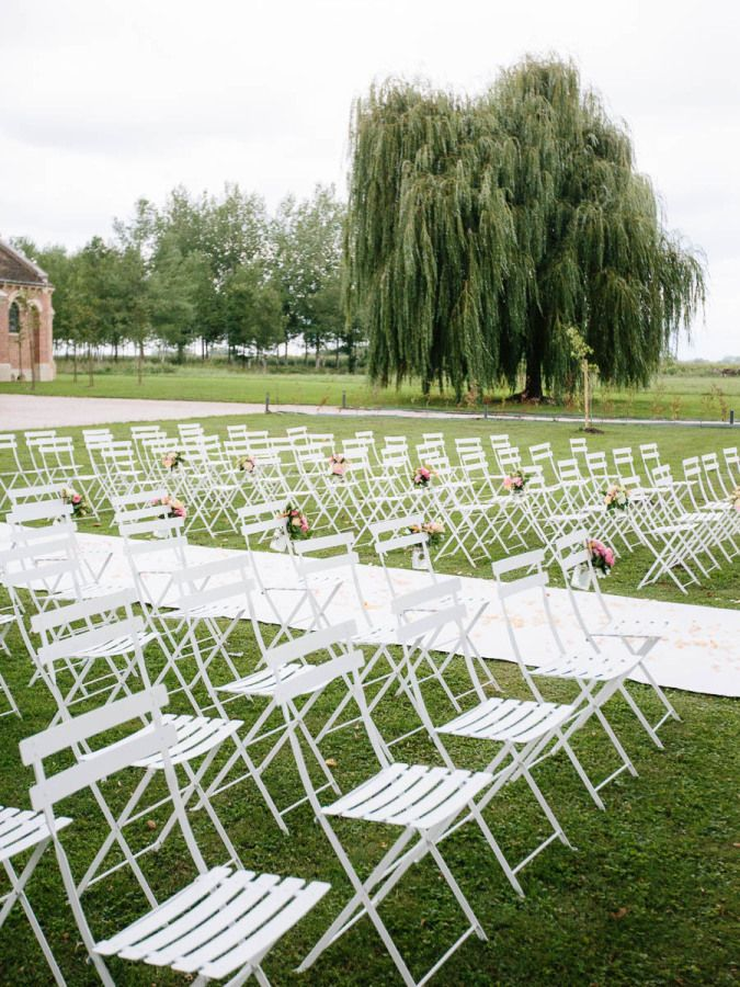 White folding ceremony chairs: http://www.stylemepretty.com/destination-weddings/france-weddings/2016/02/26/whimsical-french-countryside-chateau-wedding-in-burgundy/ | Photography: Ian Holmes Photography - http://ianholmes.net/