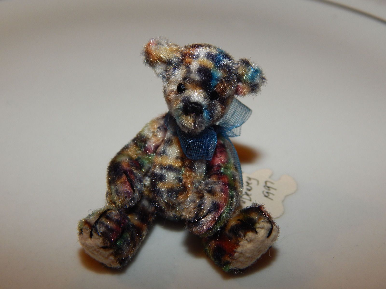 "Mary Bures, A Grand Scale, IGMA fellow - ""Dewey"", spotted teddy bear, 1 3/4"" high; sold on ebay for $20.77"