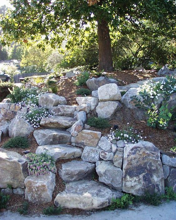 21 Landscaping Ideas For Slopes: 13 Steps And Path Ideas For Backyards Using Boulder Stones