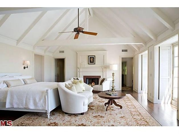 White Bedroom With Vaulted Ceilings And Wooden Ceiling Fan