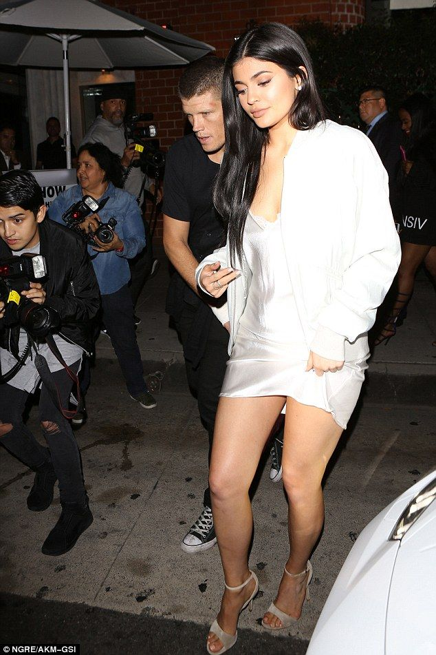 Nightie night! In contrast to her supermodel sibling's somewhat conservative ensemble, Kylie, 18, turned heads as she left the upmarket eatery in a sexy silk slip dress