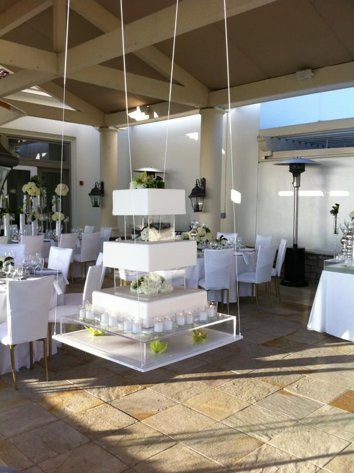 Geometric Suspended Cake Goes With Lucite Theme Can Include Some Tropical Blooms Cool Wedding Cakes Suspended Wedding Cake Wedding Cake Display