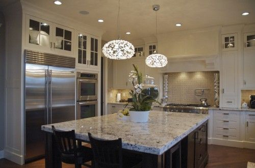 kitchen. Love the white outer cabinets and the dark island.