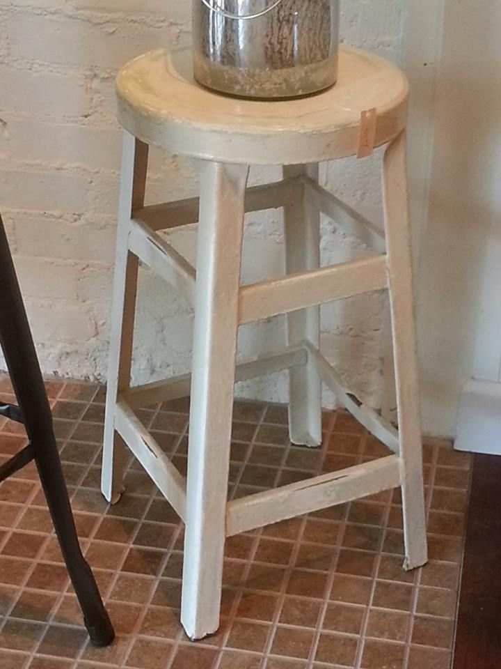 Metal stool with distressed paint