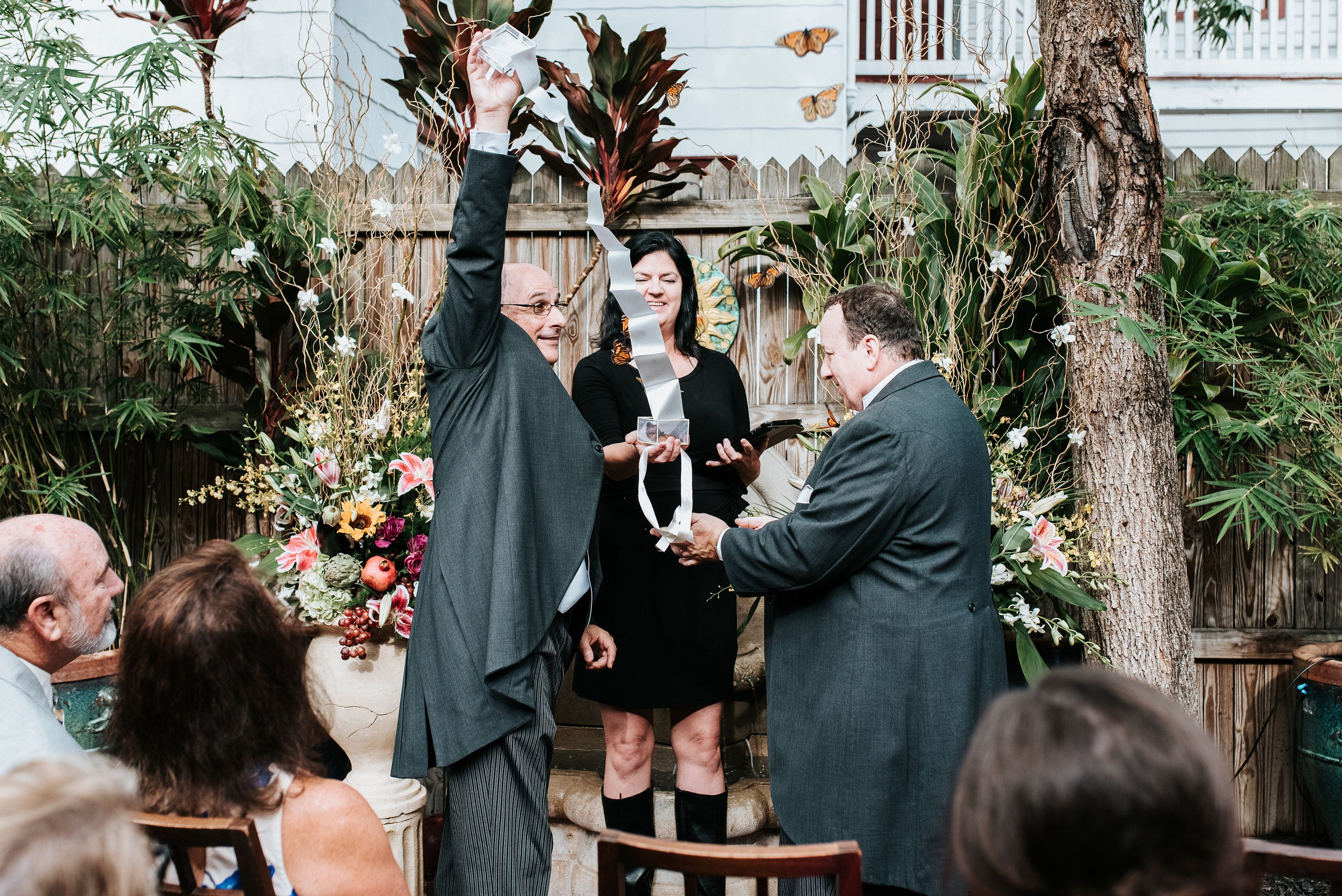 Intimate dinner party wedding with butterfly release