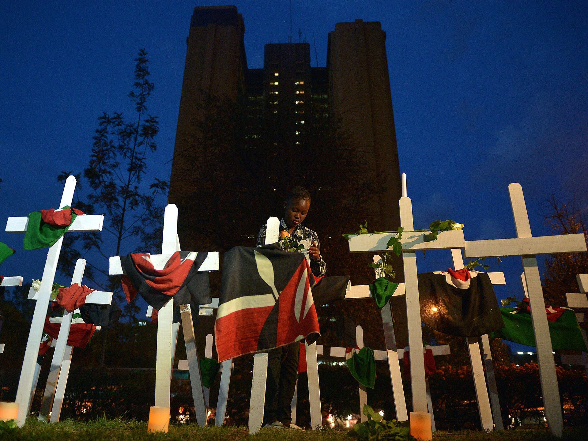 A woman stands in a display of wooden crosses dedicated to the victims of the Garissa University terror attack at Freedom-Corner in Uhuru Park in Nairobi, Kenya.  Tony Karumba, AFP/Getty Images