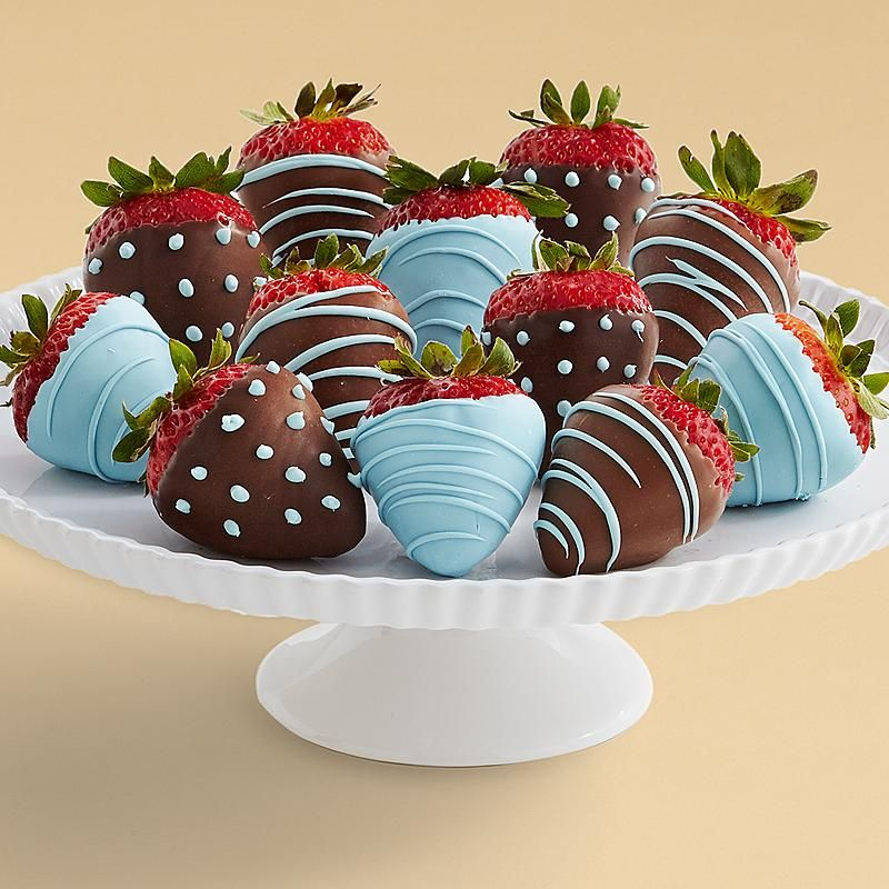 Celebrate the arrival of a baby boy with these scrumptious hand-dipped strawberries. Each mouthwatering strawberry is hand dipped and decorated with baby blue trimmings. Only the stork could deliver something sweeter!