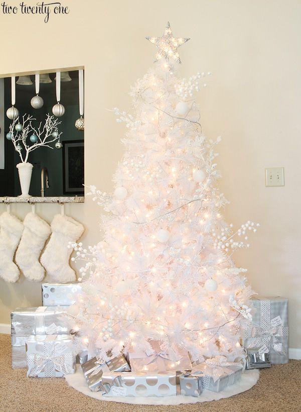 bold black and white Christmas tree decor, plaid monochrome textiles