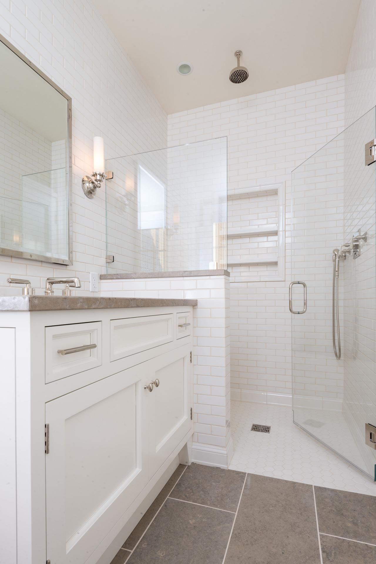this basic bathroom style becomes more streamlined and contemporary with tile walls shelving built into the shower and a glass shower door - Basic Bathroom Ideas