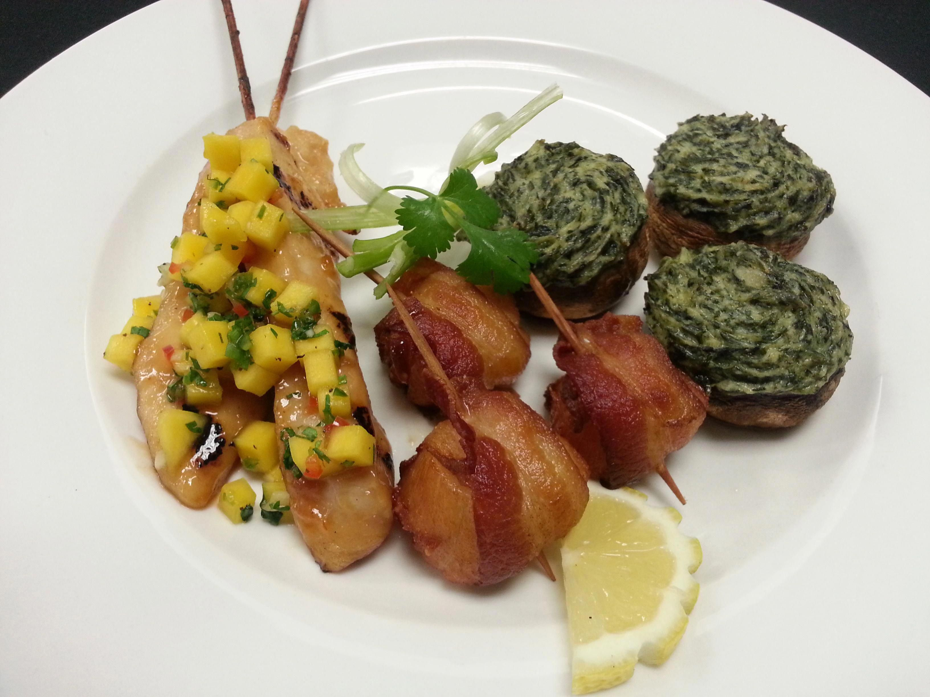 Grilled Chicken Skewers with Mango Salsa, Sea Scallops Wrapped with Bacon, and Stuffed Mushrooms Florentine #food #appetizers #horsdoeuvres #catering #chicken #mango #mangosalsa #seascallops #scallops #bacon #mushrooms #stuffedmushrooms #florentine #spinach #cheese #bitesize #yummy #foodporn #foodpics #delicious #bitesizeappetizers #appetizersbitesize