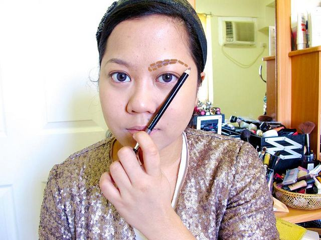 Today I'm going to share a common technique used by pros to find a face's ideal brow shape! You will need any long straight object to measure. For convenience, I used my eyebrow pencil (Avon Perfect Eyebrow Pencil in DarkBrown).