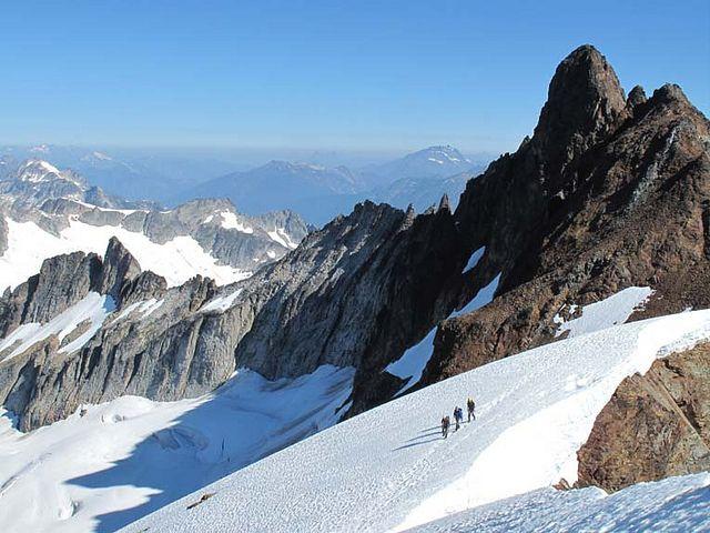 Climbers on Quien Sabe Glacier, Sahale Peak. Pablo Puruncajas photo; Mountain Madness