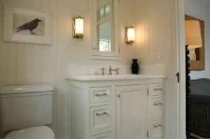 Small white bathroom with bead-board.