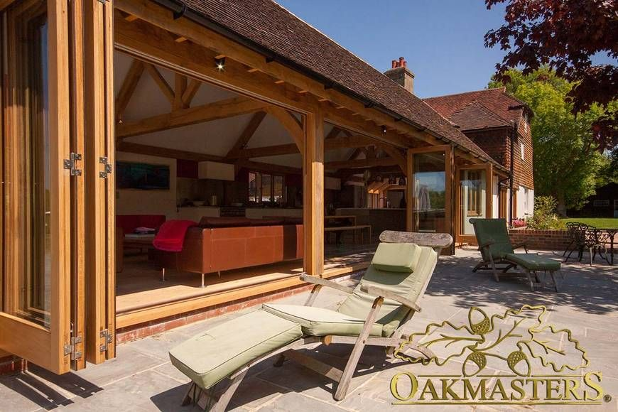 Oak sun rooms orangeries garden rooms and conservatories for Modern garden room extensions