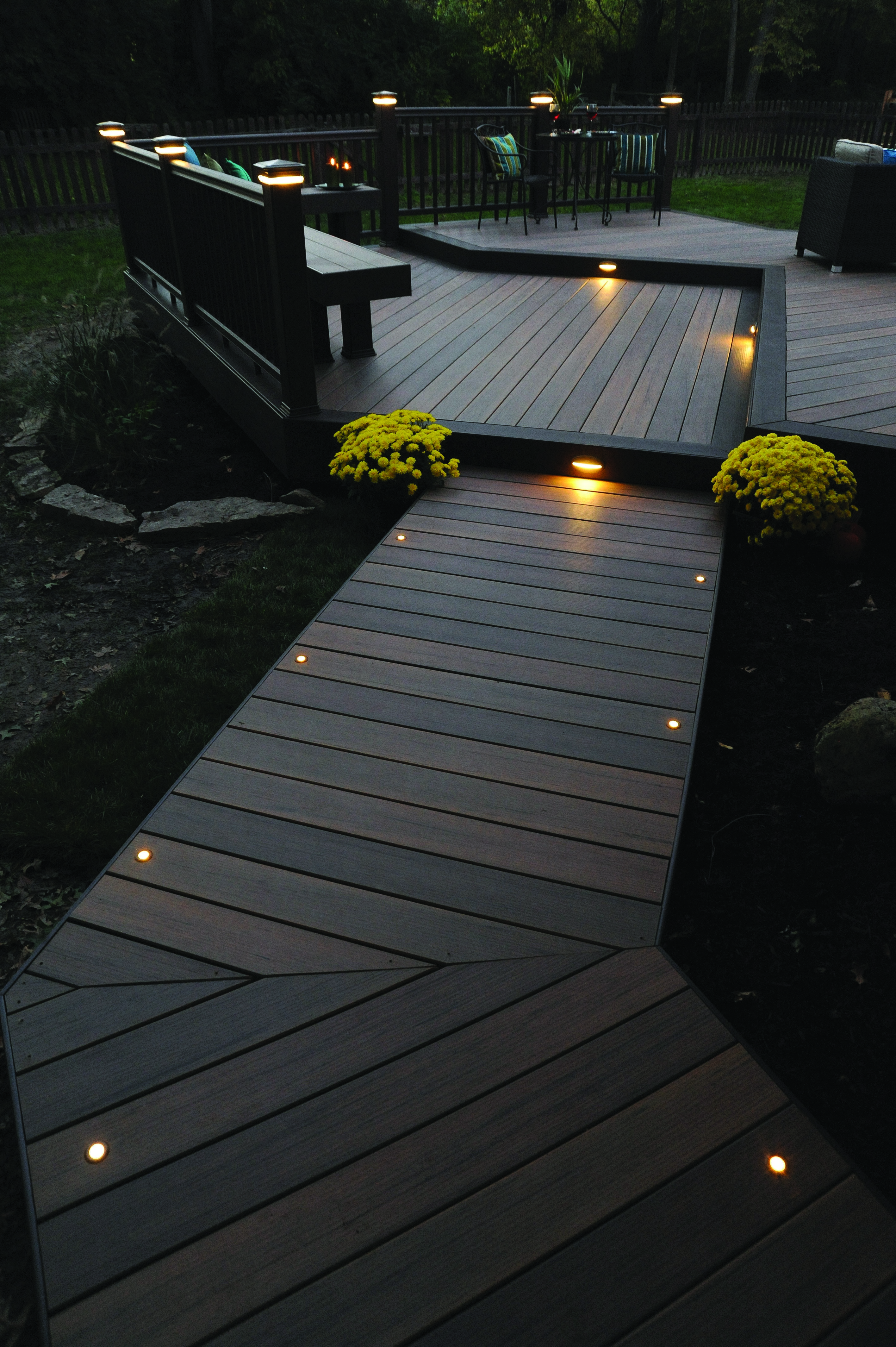 Light The Night For You And Your Guests With TimberTech Decking And Lighting.  This Deck Is From Our Legacy Collection In Tigerwood With Mocha Accents.