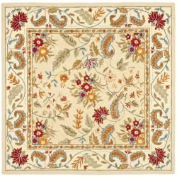 this unusual 8 square area rug features an intricate floral print in olive green blue red sage and gold the wool rug is handhooked onto a cotton