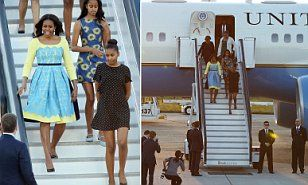 The U.S. First Lady is joined by her daughters Sasha and Malia and mother Marian Robinson for a trip to the UK, including visiting Mulberry School for Girls in Tower Hamlets today.
