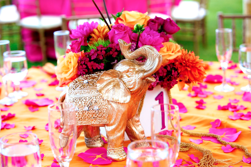 Beautiful golden elephant and pink flower centerpieces at