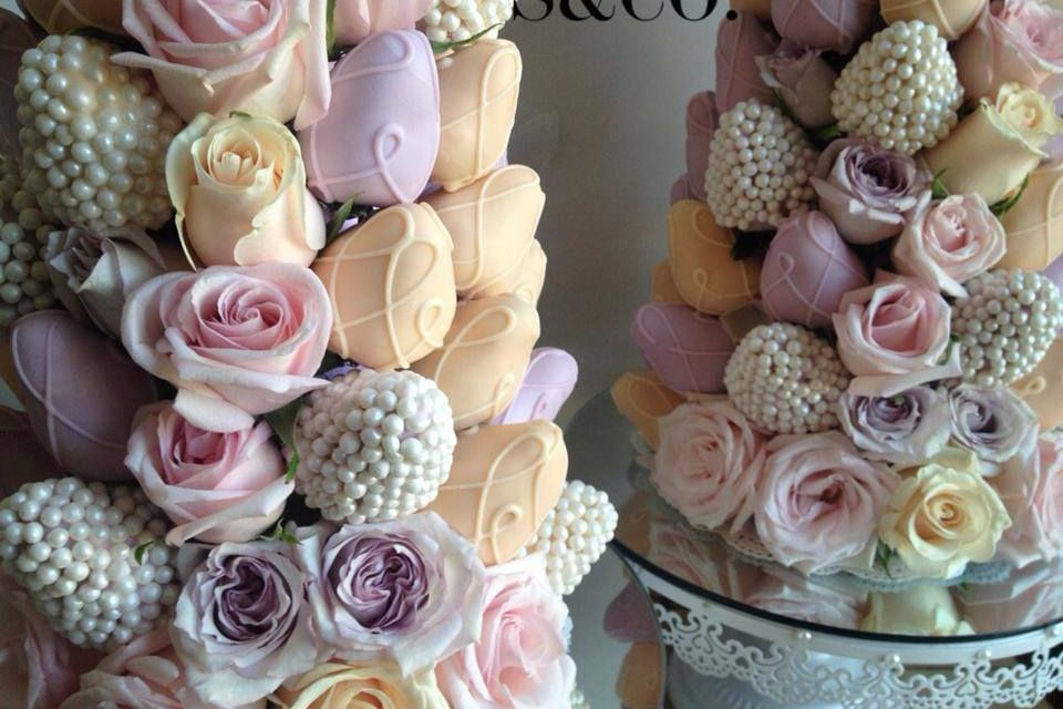 Chocolate covered strawberries in pastel colors. Use white
