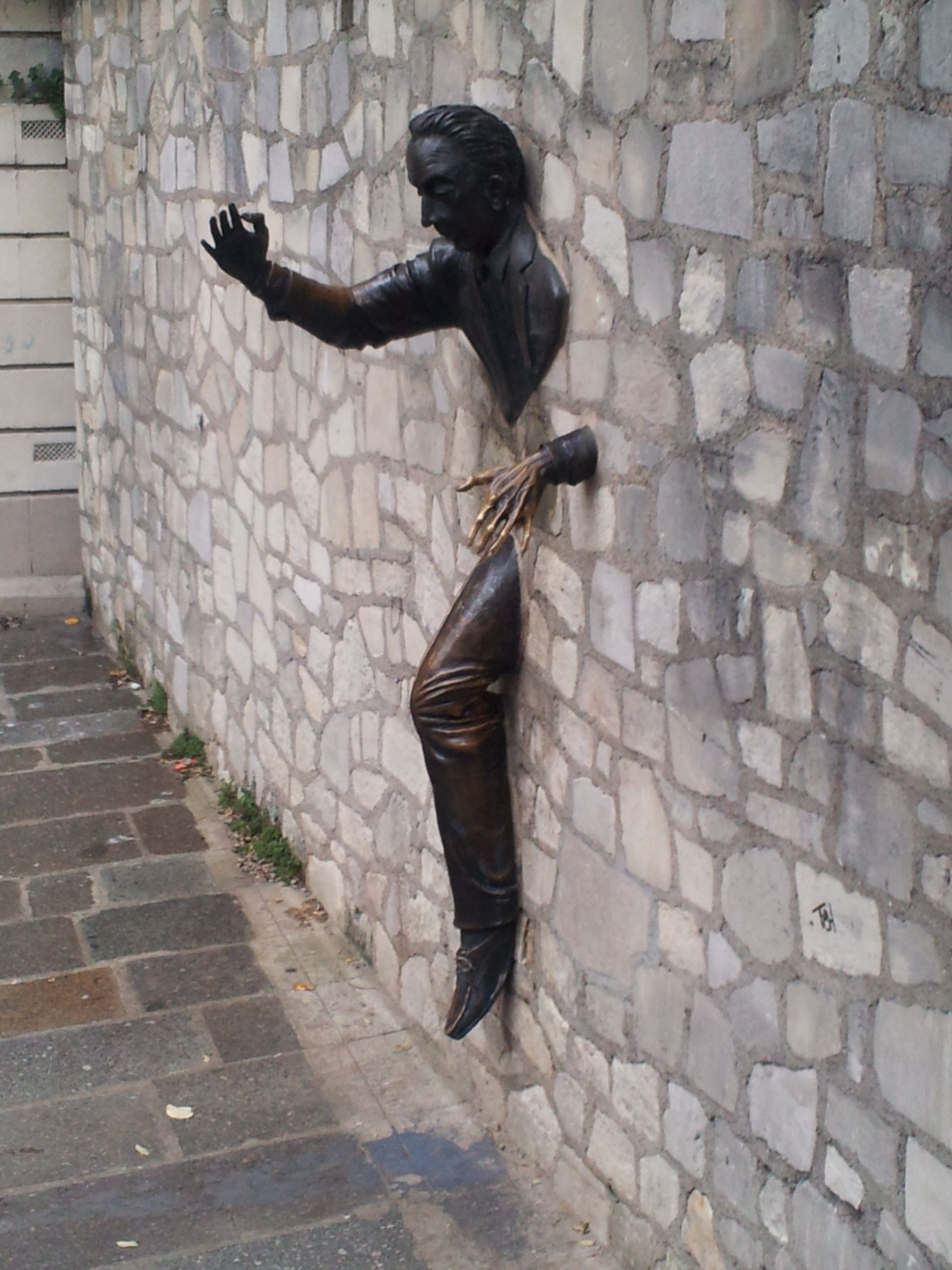 paris street art sculpture is coming out of the wall paris trip pinterest paris street. Black Bedroom Furniture Sets. Home Design Ideas