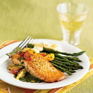 A short soak in olive oil infuses this quick salmon recipe with delicious flavor and helps aid the cooking process. Top the fish with a quick, fresh basil sauce for a quick weeknight meal or an easy main dish when entertaining.