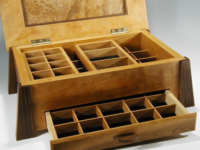 Handmade wooden jewelry box made of cherry and burl this photo