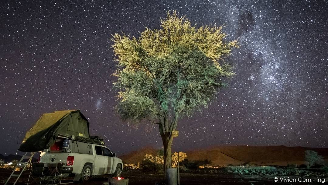 """Camped out in the """"bakkie"""" under the Milky Way. """"The best way to get around is in a pickup truck affectionately known as a """"bakkie"""" adapted for camping with a tent on the roof. This means you can stop and camp anywhere you need to."""" In July 2015 Earth scientist @drvivcumming explored Namibia with a group of geologists led by Paul Hoffman. Read more about her time in the Namib desert here: http://bbc.in/1QogMCM by bbcearth"""