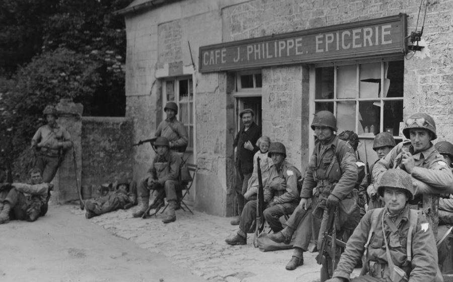 Normandy, June 6th.  Camo parachute helmet covers with nets.