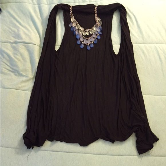 Light Cardigan Sleeveless, black Cardigan. It's light and a great addition to a dress or tank top for a little more coverage. Sweaters Cardigans