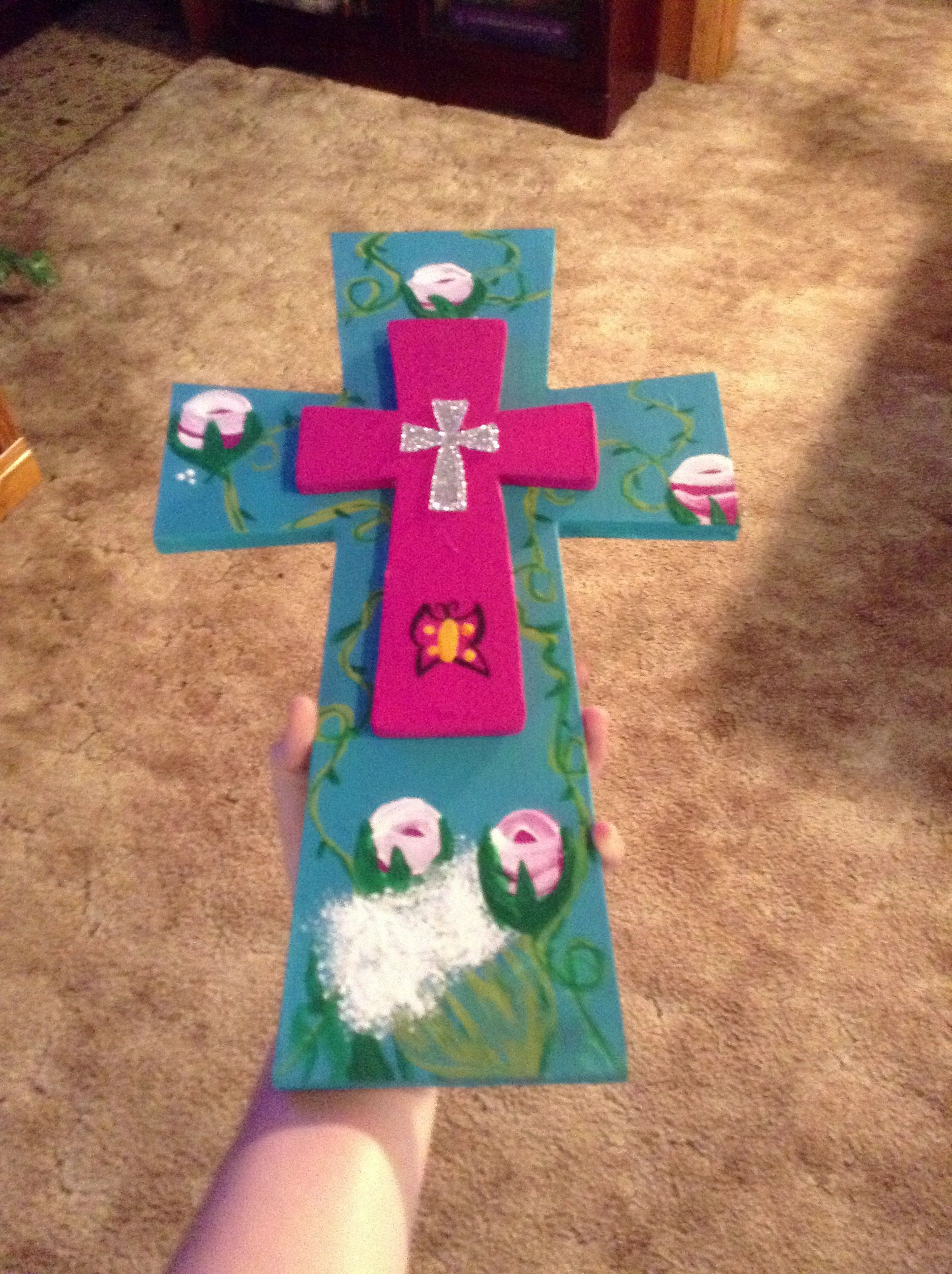 A cross with roses and other types of flowers with vines all around a cross with roses and other types of flowers with vines all around it also has izmirmasajfo