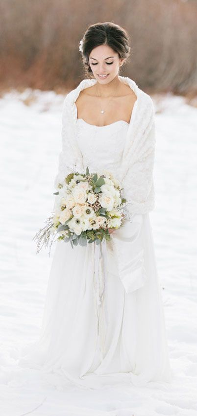 The Size Of Bouquet Winter Wedding Inspiration Portraits In Snow Featuring Bridal Dress And Fur Shawl By Marisol Aparicio