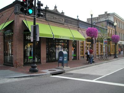 Lime Green Awning On A Red Brick Building Store Fronts Building Exterior Brick
