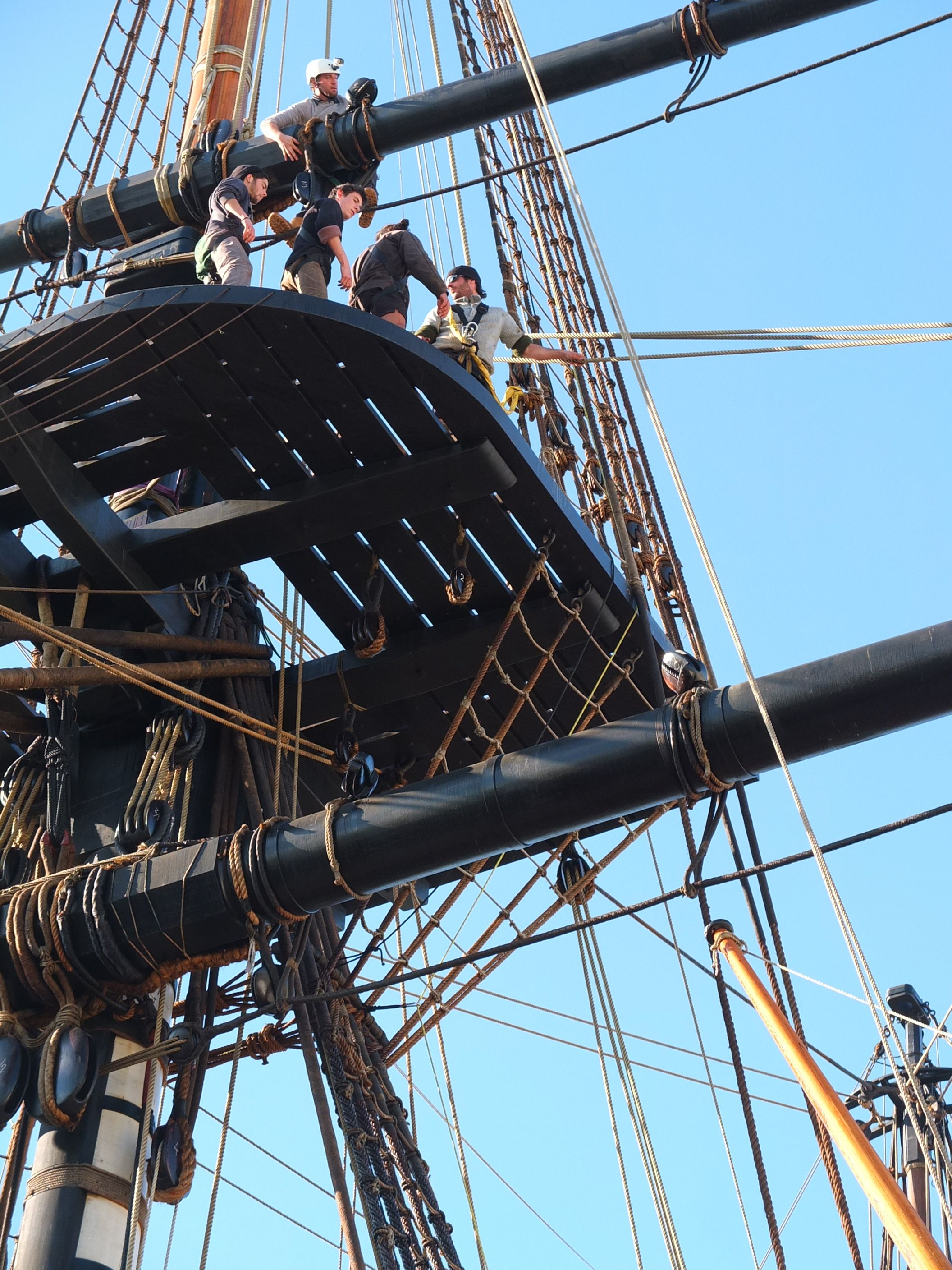The topmen use the shrouds–the rope ladders seen above these crew ... for Rope Ladder Ship  54lyp