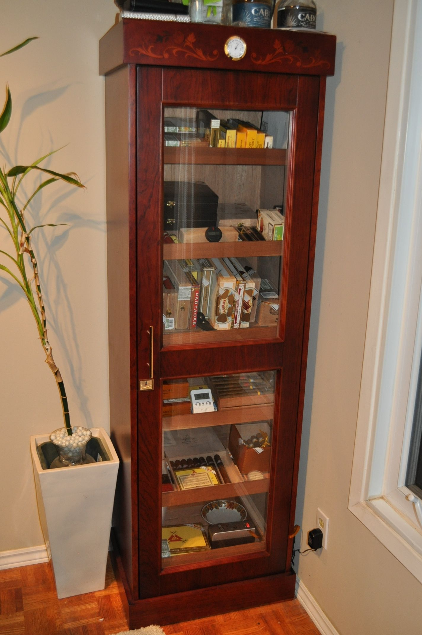 Our tower cigar humidor full of fine Cuban cigars At Cigar Star