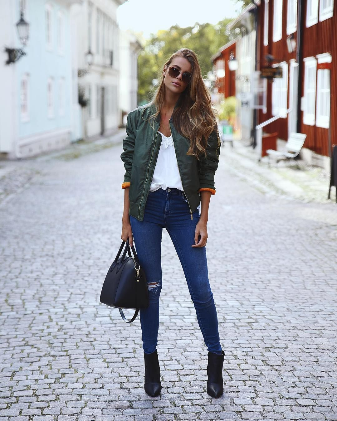 a454df992b7 Green bomber jacket + white t-shirt + ripped jeans + black ankle boots +  black bowling bag   badass street style this fall and winter.