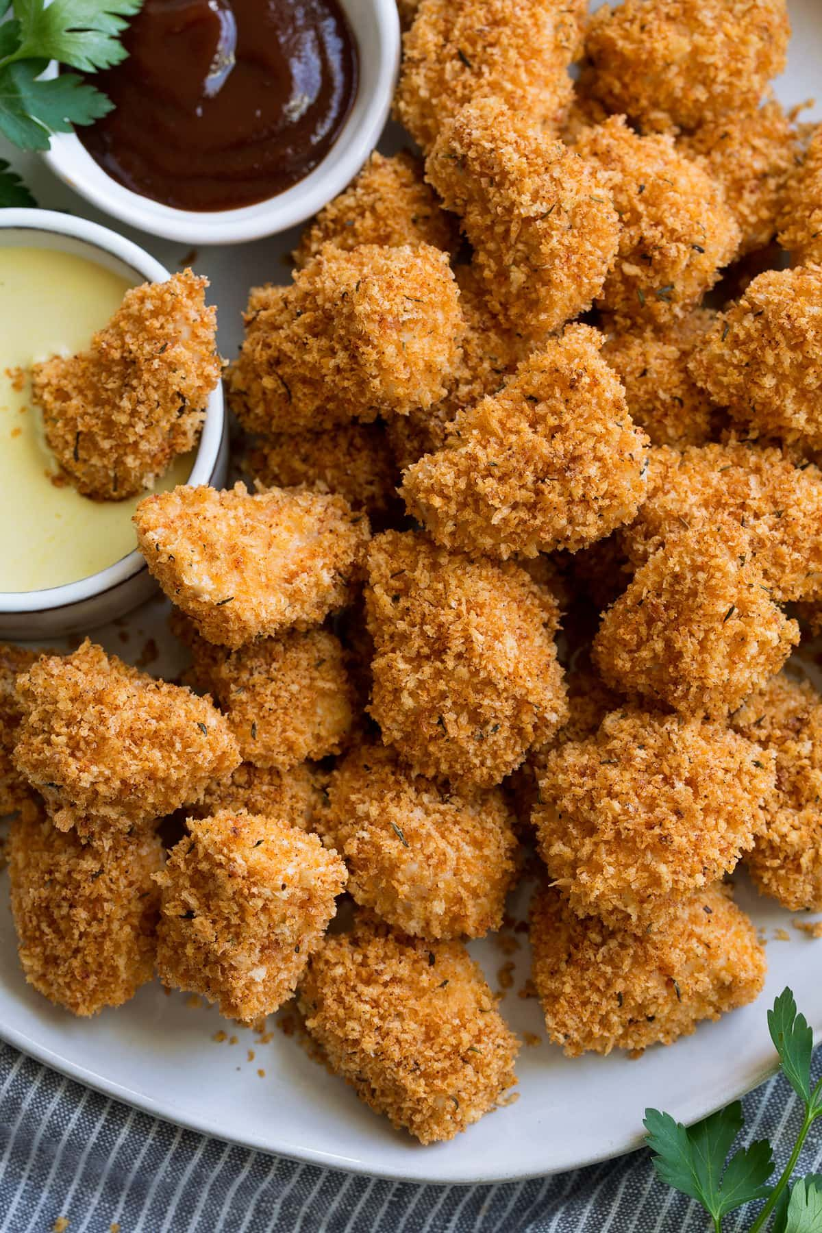 Homemade Chicken Nuggets Made With Real Ingredients These Are Oven Baked Instead Of Fried So In 2020 Baked Chicken Nuggets Chicken Nuggets Homemade Chicken Nuggets