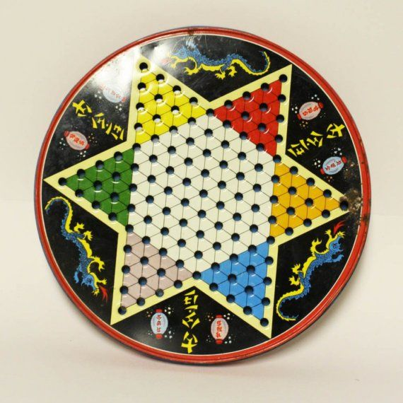 Chinese Checkers in a Tin with Regular Checkers on the other side and marbles and red/black checkers inside.