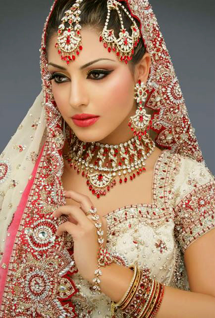 Traditional red and gold Indian wedding saree.