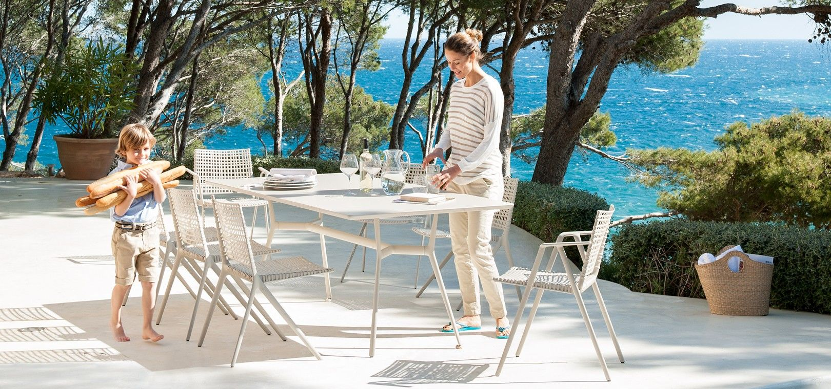 ... Of Aluminium Outdoor Furniture That Consists Of Two Garden Chairs, A  Rectangular Outdoor Table And Two Bistro Tables, Designed By Lievore  Altherr Molina