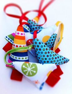 These fabric Christmas ornaments are colorful and festive! Stash-bust your fabric cabinet with this tutorial for Mini Fabric Tree Christmas Ornaments.