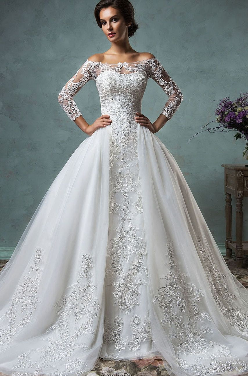 e2726467fe10 A gorgeous mermaid style gown with lace appliques from top to bottom.  Traditional off-shoulder