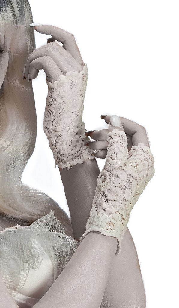 Our Ghost White Fingerless Lace Gloves includes a pair of wrist-length white lace fingerless gloves. Bring elegance to your ghostly spirit with a beautifully eerie taste in fashion. Our women's Ghost Fingerless Lace Gloves is an ideal accessory for your Victorian, steampunk, bride or ghost costume. One size fits most teens and adults.