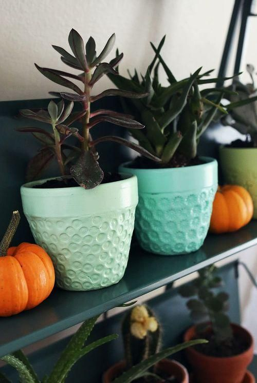 terra cotta pots covered in embossed clay and painted!