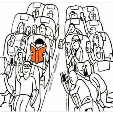 Be the person with the orange book, while everyone else taking pictures of you